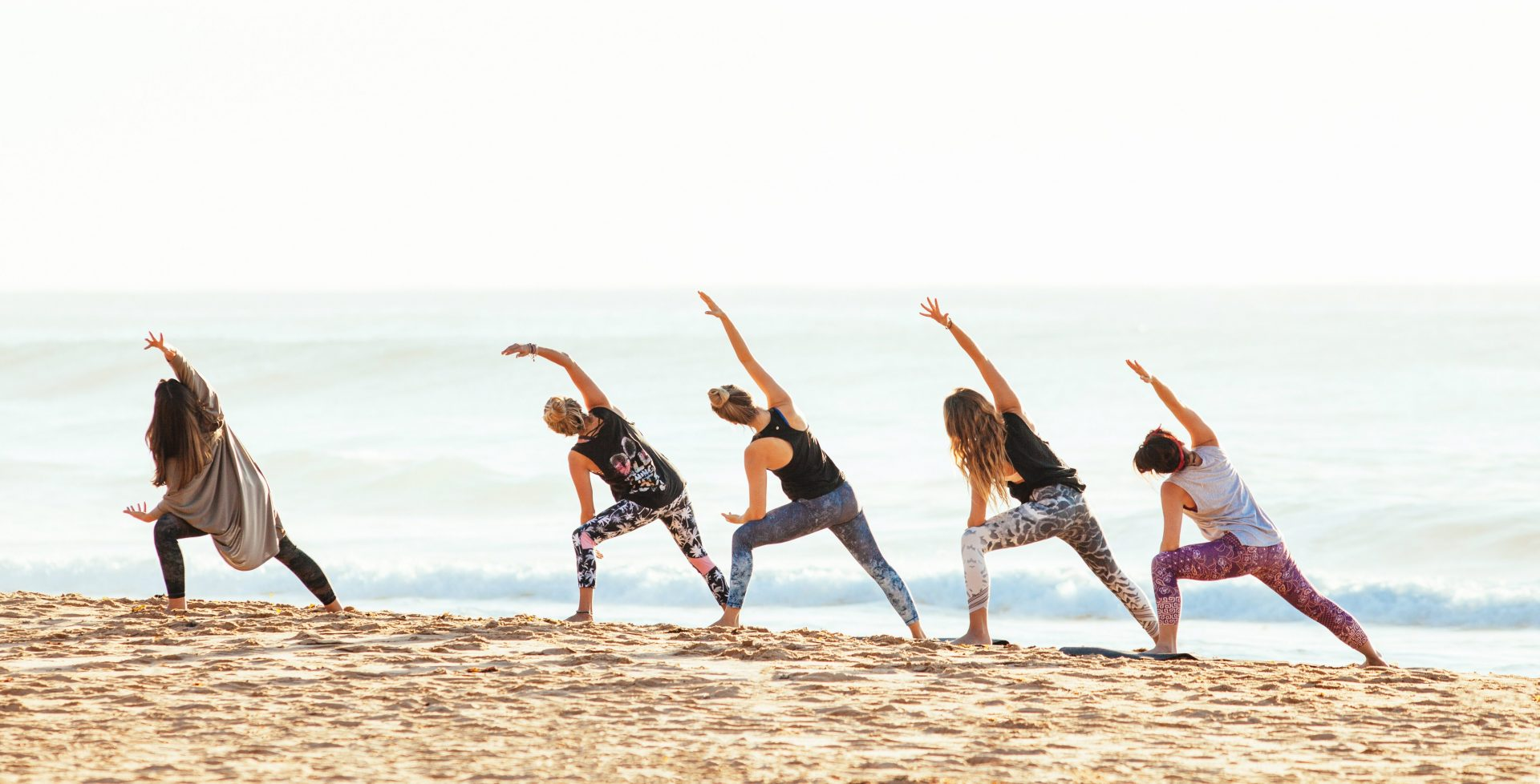 Group Yoga On Beach