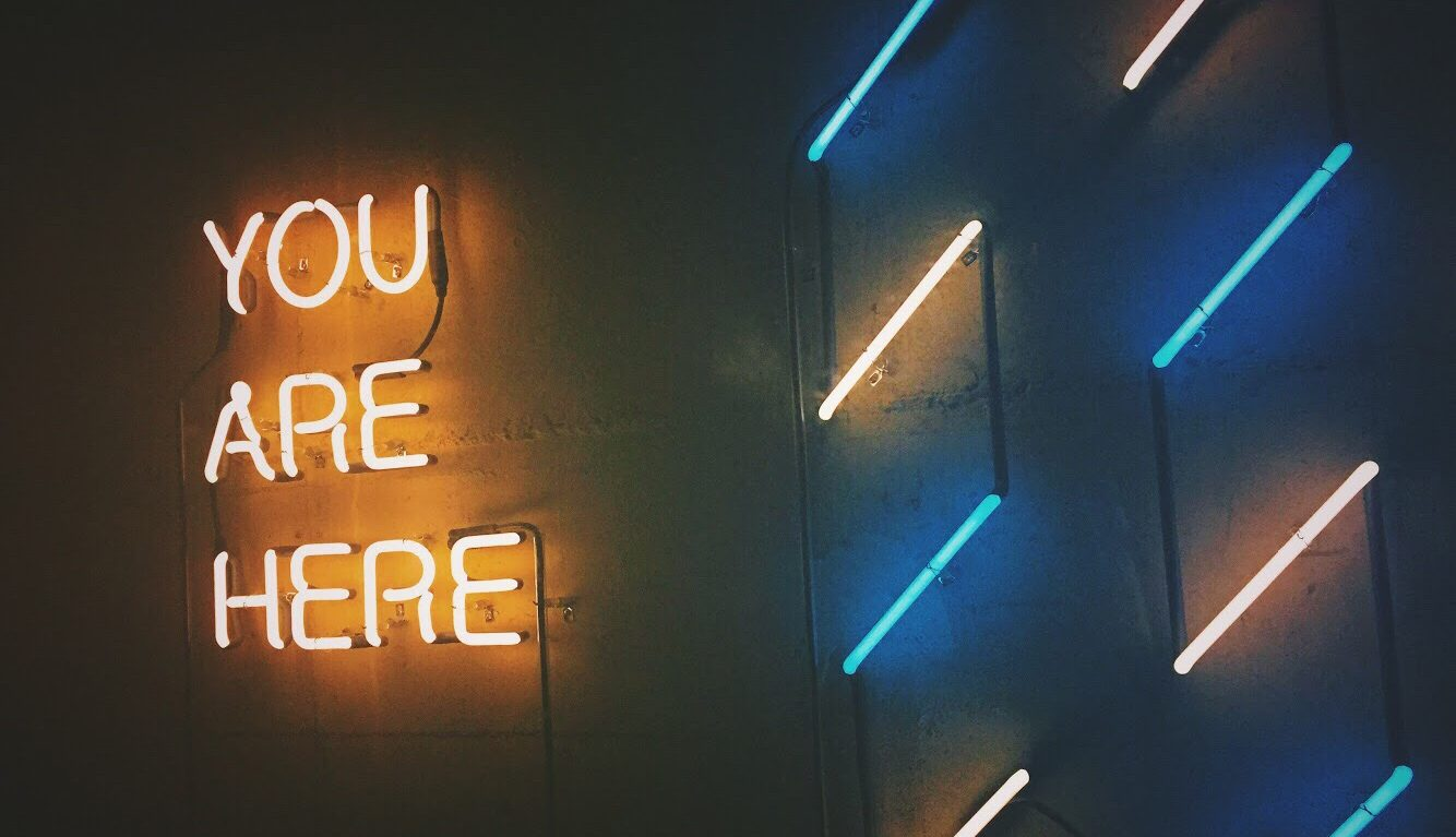 neon sign you are here